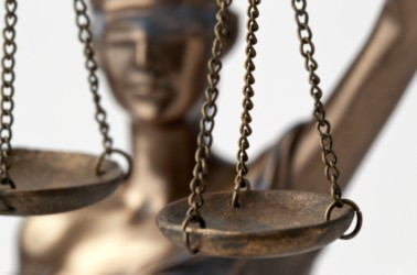 cropped-horizontal-close-up-of-bronze-blind-lady-justice.jpg